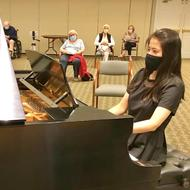 Photo of Opportunity Fund grantee Leona Cheung playing piano